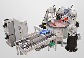 Fully automatic vibratory grinding in the surf finisher with part feed and two robot arms